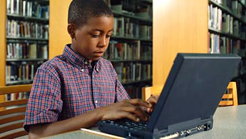 image of a boy using a laptop